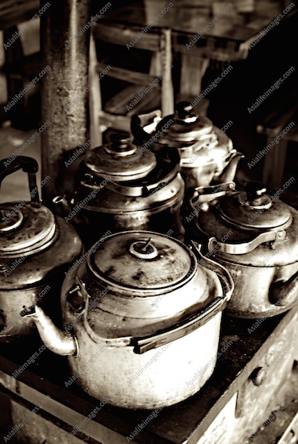 Kettles crowed on a wood oven